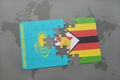 förbrylla med nationsflaggan av kazakhstan och Zimbabwe på en världskarta Royaltyfria Bilder