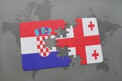 förbrylla med nationsflaggan av Kroatien och georgia på en världskartabakgrund Arkivfoton