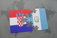 förbrylla med nationsflaggan av Kroatien och Guatemala på en världskarta Arkivbilder