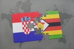 förbrylla med nationsflaggan av Kroatien och Zimbabwe på en världskarta Arkivfoton