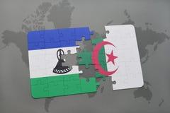 förbrylla med nationsflaggan av Lesotho och Algeriet på en världskarta Royaltyfri Bild