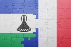förbrylla med nationsflaggan av Lesotho och Frankrike Royaltyfri Bild