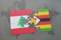 förbrylla med nationsflaggan av Libanon och Zimbabwe på en världskartabakgrund Royaltyfria Bilder