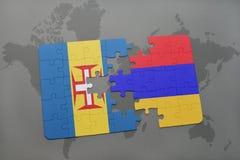 förbrylla med nationsflaggan av madeira och Armenien på en världskartabakgrund Royaltyfri Fotografi