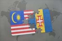 förbrylla med nationsflaggan av Malaysia och madeira på en världskartabakgrund Royaltyfri Bild