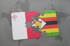 förbrylla med nationsflaggan av malta och Zimbabwe på en världskarta Royaltyfria Foton
