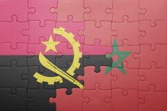förbrylla med nationsflaggan av Marocko och Angola Royaltyfria Foton