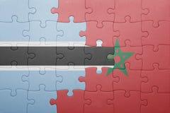 förbrylla med nationsflaggan av Marocko och Botswana Royaltyfria Foton