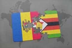 förbrylla med nationsflaggan av moldova och Zimbabwe på en världskarta Royaltyfri Foto