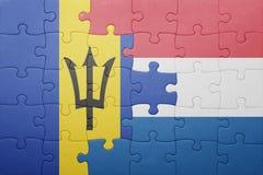 förbrylla med nationsflaggan av Nederländerna och Barbados Arkivbild