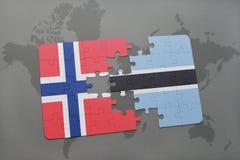 förbrylla med nationsflaggan av Norge och Botswana på en världskarta Royaltyfri Fotografi