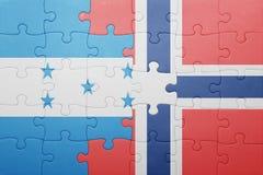 förbrylla med nationsflaggan av Norge och Honduras Royaltyfria Foton