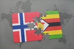 förbrylla med nationsflaggan av Norge och Zimbabwe på en världskarta Royaltyfria Bilder