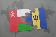 förbrylla med nationsflaggan av Oman och Barbados på en världskartabakgrund Royaltyfri Fotografi