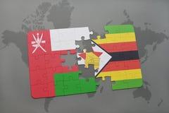 förbrylla med nationsflaggan av Oman och Zimbabwe på en världskartabakgrund Royaltyfria Bilder