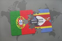 förbrylla med nationsflaggan av Portugal och Swaziland på en världskartabakgrund Arkivfoto