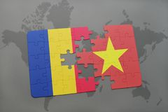 förbrylla med nationsflaggan av Rumänien och Vietnam på en världskarta Royaltyfri Foto