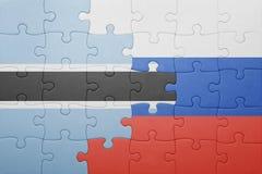 förbrylla med nationsflaggan av Ryssland och Botswana Royaltyfri Bild