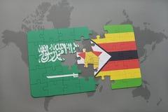 förbrylla med nationsflaggan av Saudiarabien och Zimbabwe på en världskartabakgrund Arkivfoton