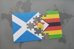 förbrylla med nationsflaggan av Skottland och Zimbabwe på en världskarta Arkivbilder