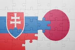 Förbrylla med nationsflaggan av Slovakien och Japan Fotografering för Bildbyråer