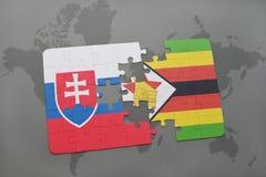 förbrylla med nationsflaggan av Slovakien och Zimbabwe på en världskarta Fotografering för Bildbyråer