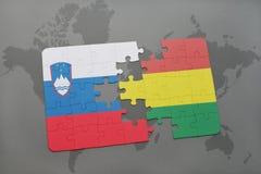 förbrylla med nationsflaggan av Slovenien och Bolivia på en världskarta Royaltyfria Bilder