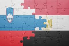 förbrylla med nationsflaggan av Slovenien och Egypten Royaltyfri Fotografi