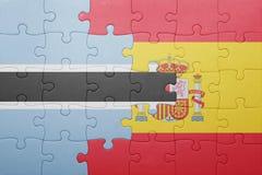 förbrylla med nationsflaggan av Spanien och Botswana Fotografering för Bildbyråer