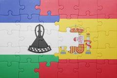 förbrylla med nationsflaggan av Spanien och Lesotho Royaltyfri Fotografi