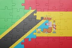 förbrylla med nationsflaggan av Spanien och Tanzania Arkivfoton