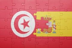 förbrylla med nationsflaggan av Spanien och Tunisien Royaltyfria Bilder