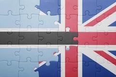 förbrylla med nationsflaggan av Storbritannien och Botswana Royaltyfri Fotografi