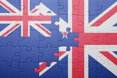 Förbrylla med nationsflaggan av Storbritannien och Nya Zeeland Arkivfoto