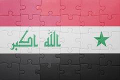 Förbrylla med nationsflaggan av Syrien och Irak Arkivbild
