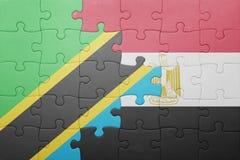 förbrylla med nationsflaggan av Tanzania och Egypten Arkivbild