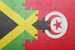 förbrylla med nationsflaggan av Tunisien och Jamaica Arkivfoton