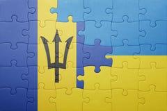 förbrylla med nationsflaggan av Ukraina och Barbados Fotografering för Bildbyråer