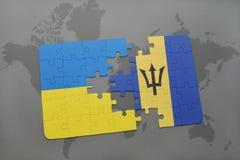 förbrylla med nationsflaggan av Ukraina och Barbados på en världskarta Royaltyfri Foto