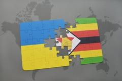 förbrylla med nationsflaggan av Ukraina och Zimbabwe på en världskarta Arkivbild