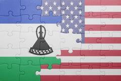 förbrylla med nationsflaggan av USA och Lesotho Arkivfoton