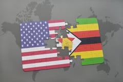 förbrylla med nationsflaggan av USA och Zimbabwe på en världskartabakgrund Arkivfoto