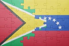 Förbrylla med nationsflaggan av Venezuela och guyana royaltyfri fotografi