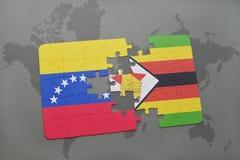 förbrylla med nationsflaggan av Venezuela och Zimbabwe på en världskarta Royaltyfri Fotografi