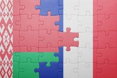 Förbrylla med nationsflaggan av Vitryssland och Frankrike Arkivbild