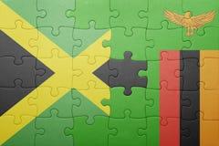 förbrylla med nationsflaggan av zambiaen och Jamaica Royaltyfria Foton