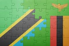 förbrylla med nationsflaggan av zambiaen och Tanzania Arkivfoto