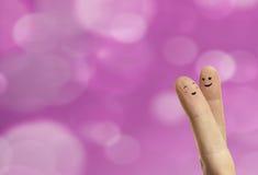 Förbunden kramen av lyckliga fingersmileys med förälskelse Royaltyfria Bilder