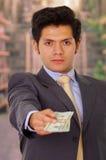 Fördärvad ung affärsman med några pengar från en skurk royaltyfria bilder