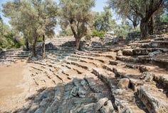 Fördärvar av den antika grekiska teatern, Kedrai, den Sedir ön, golf av Gokova, Turkiet Royaltyfria Bilder